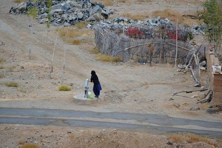 Woman using water pump