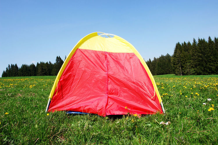 Home Adventure Beauty In Nature Camping Clear Sky Day Grass Growth Nature No People Outdoors Shelter Sky Tent Tree