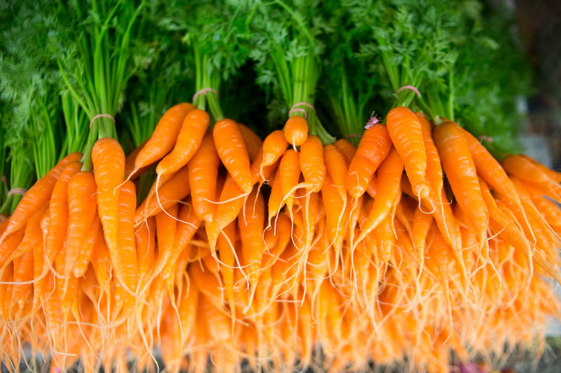Baby Carrots Carrot Carrots Close-up Day Food Food And Drink Freshness Green Color Healthy Eating Market Nature No People Orange Orange Color Organic Outdoors Raw Food Retail  Ripe Root Vegetable Selective Focus Vegetable Wellbeing