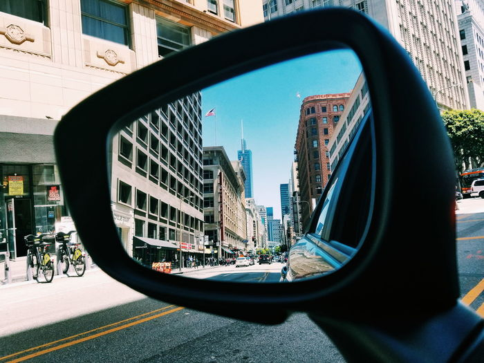 Reflection Of City On Side-View Mirror