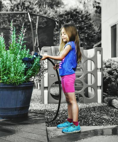 Outdoors Long Hair Lifestyles Child EyeEm Best Shots EyeEm Gallery EyeEmBestPics Gardening Garden Photography Girl Colorsplash Color Portrait Casual Shooting EyeEmBestEdits EyeEmNewHere Feeling Creative Art Photography Abstract Full Length One Person Looking Down Standing Casual Clothing Watering Can Day