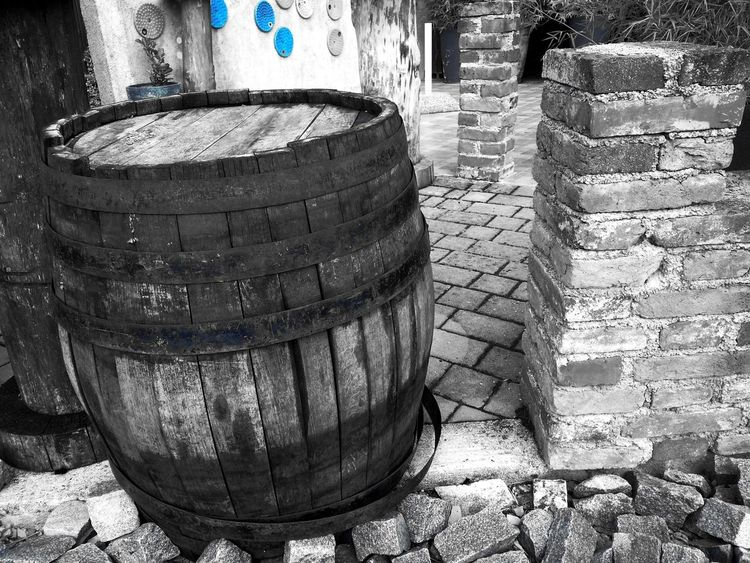 No People Barrel Day Old Brick Wall Art Artistic Barrel Art Black And White With A Splash Of Colour Blue EyeEm Eyeem Market Wood - Material Wood Plates EyeEmBestPics Outdoor Photography Eye For Photography Eye4photography  Exceptional Photographs Streetphotography Street Art ArtWork Architecture Monochrome The Week On EyeEm EyeEmNewHere