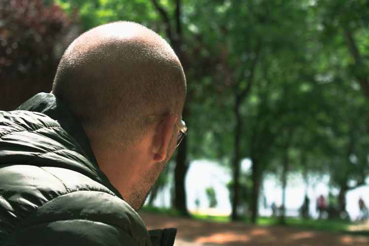 Close-up of man against trees in park