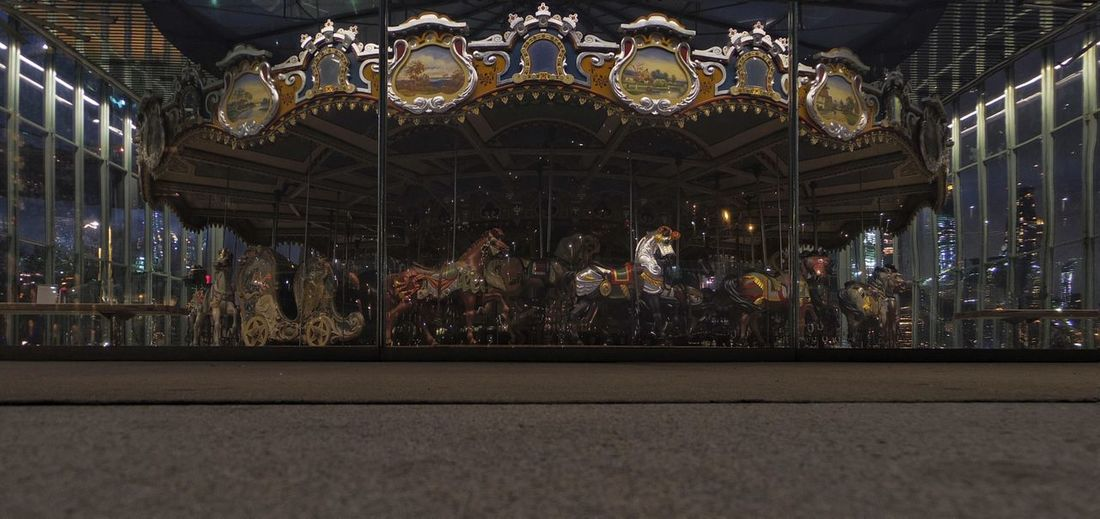 Closed for the season. Carousel Night Illuminated Amusement Park Ride No People Glass Enclosed Night Time Reflection Photography