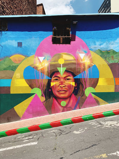 Portrait of smiling girl against multi colored wall