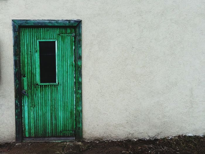 Green Closed Door Of Old House