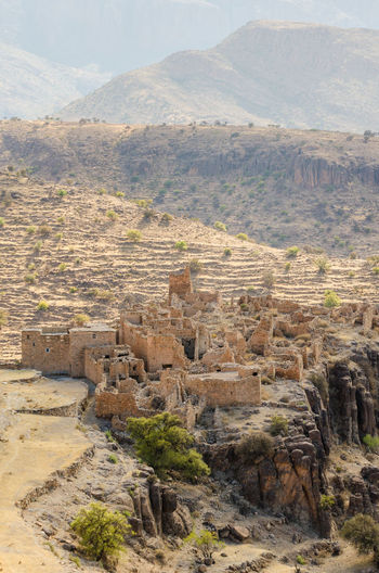 Aerial view of old ruin of moroccan kasbah in arid landscape of anti-atlas mountains, morocco