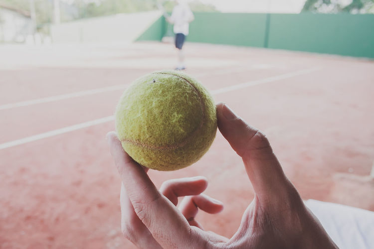 Adult Ball Close-up Focus On Foreground Human Hand Lifestyles Real People Sport Tennis Tennis Ball Tennis Racket