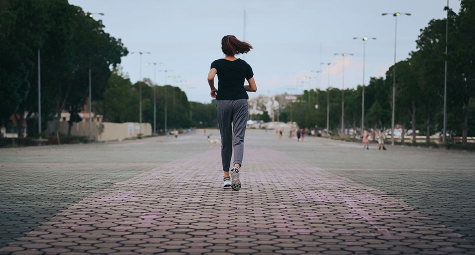 Back view point of young women running in the evening , healthy , inspiration and motivation concept