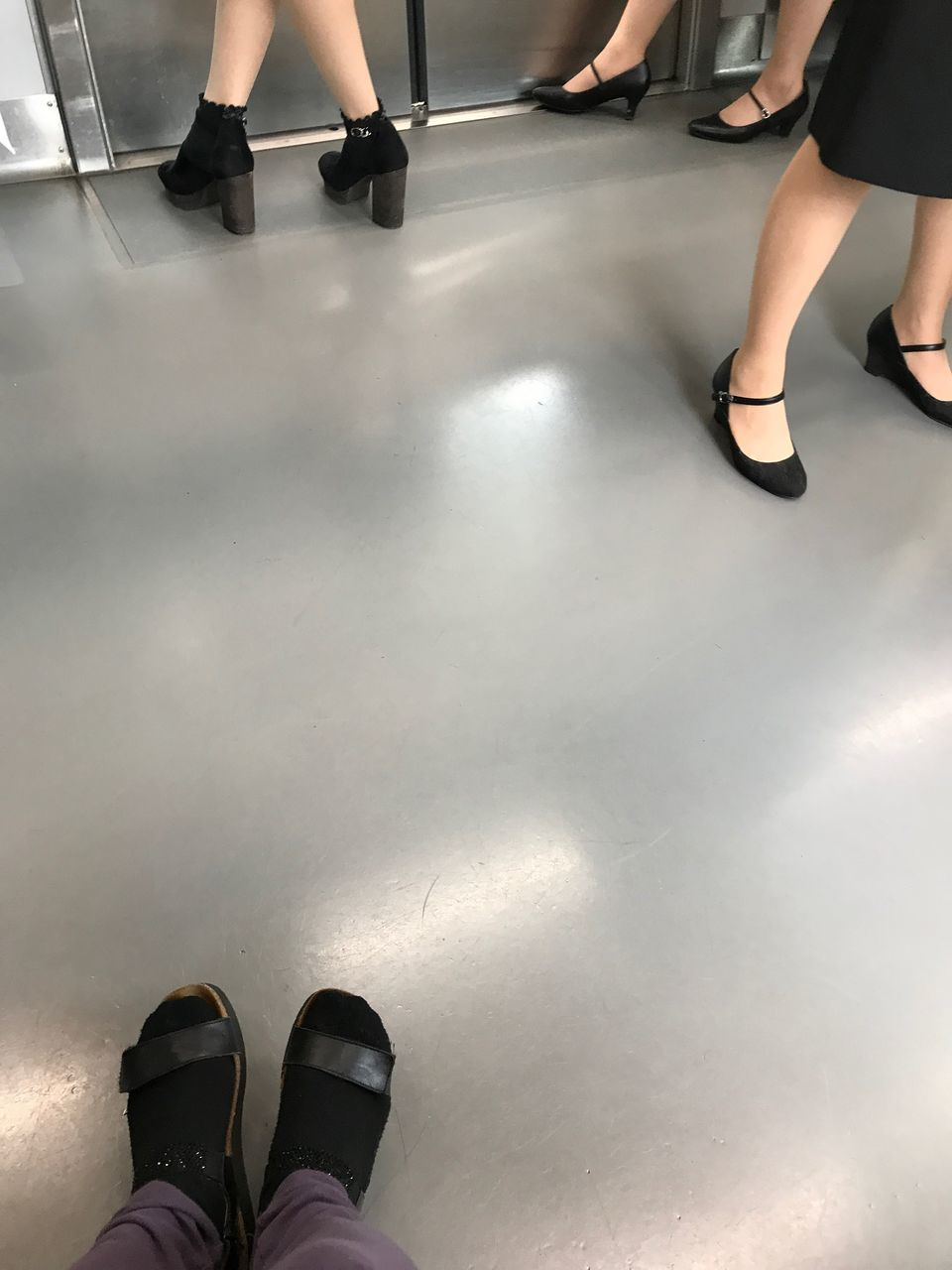 low section, human leg, shoe, real people, standing, human body part, indoors, high angle view, two people, lifestyles, men, women, young adult, day, adult, people