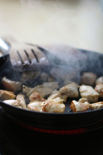 Close-up of meat in cooking pan