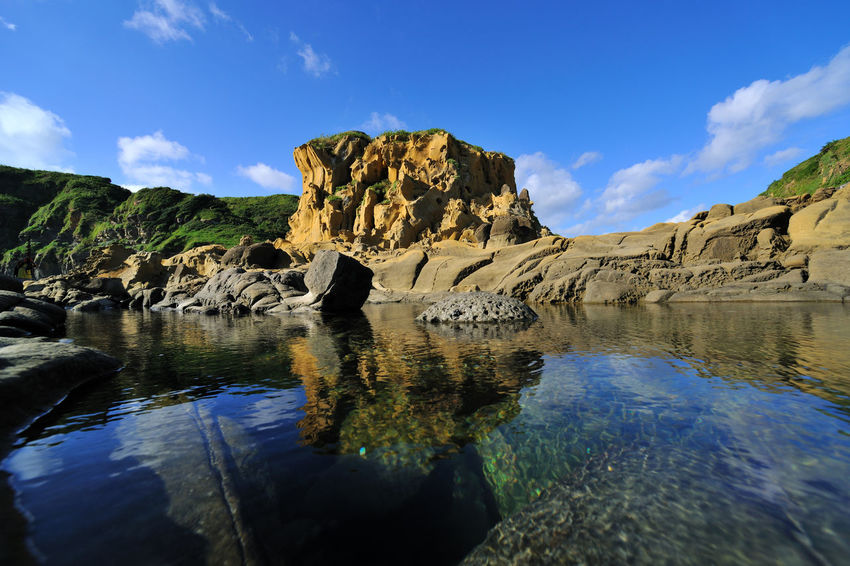 Geological landscape of blue sky, Taiwan Keelung Hepingdao Park, strange rock shapes. Natural Rock Taiwan Beauty In Nature Blue Coastal Day Geology Keelung Landscape Nature No People Outdoors Park Peace Island Peaceful Reflection Rock - Object Scenics Sea Seaside Sky Tranquility Water Waterfront