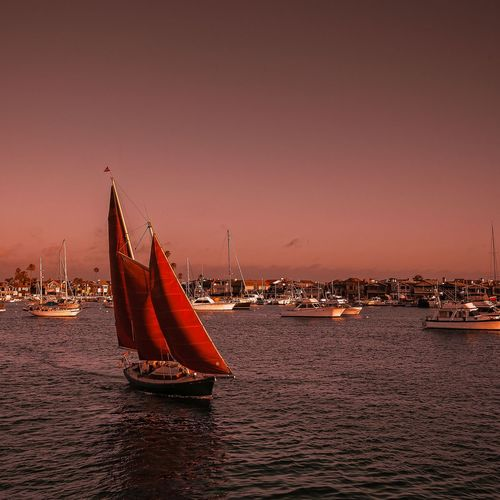 Red sails at sunset Nautical Vessel Sunset Red Water Sea No People Outdoors Cityscape Day sailing, harbor, sailboat
