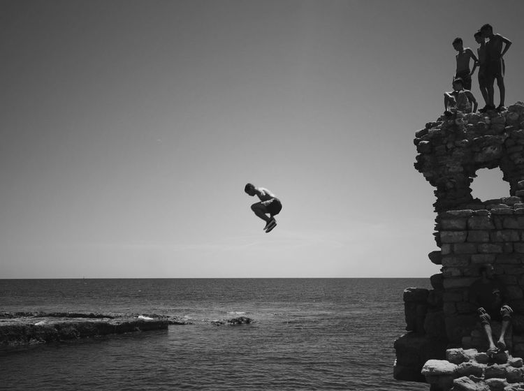 Breathing Space Sea Horizon Over Water Water Mid-air Leisure Activity Clear Sky Real People Copy Space Lifestyles Men Outdoors Nature Full Length Beach Sky Vacations Day Jumping Scenics Beauty In Nature Young Summer Blackandwhite Summer Exploratorium