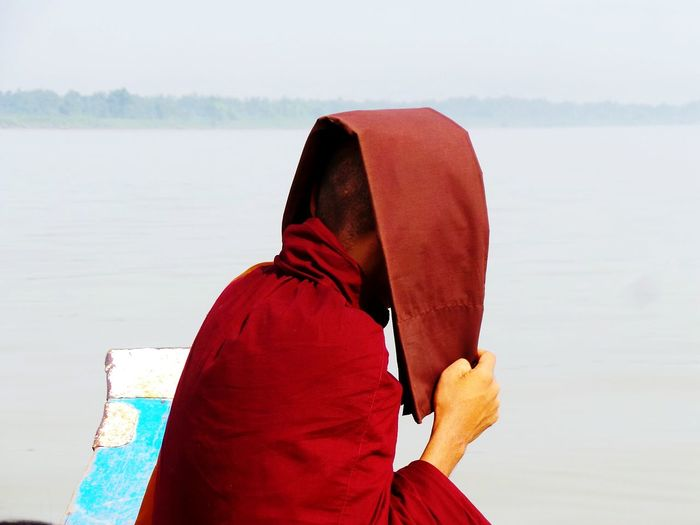 On our way. Monk  Hiding Protection Sunny Day Fishing Boat Other Side Monestary Learning Buddhism Buddhist Monks