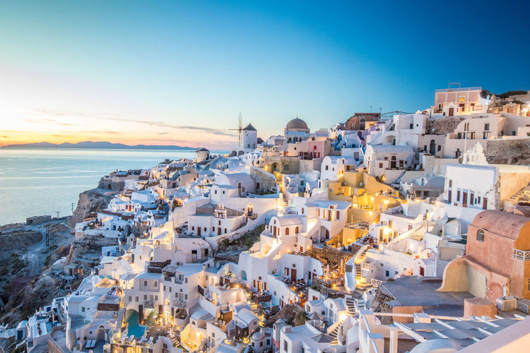 View of Santorini Greece Santorini Santorini, Greece Santorini Greece Architecture Sky Building Exterior City Built Structure Water Sea Building Residential District High Angle View Nature Crowded Town Travel Destinations TOWNSCAPE Sunlight Outdoors Cityscape