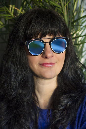 Close-up portrait of woman with sunglasses