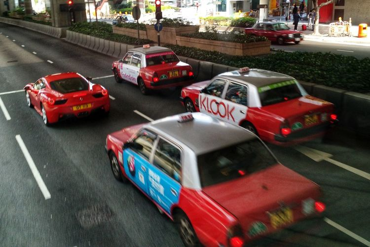 One of these things is not like the other. Ferrari Traffic Car City Land Vehicle Red Taxi