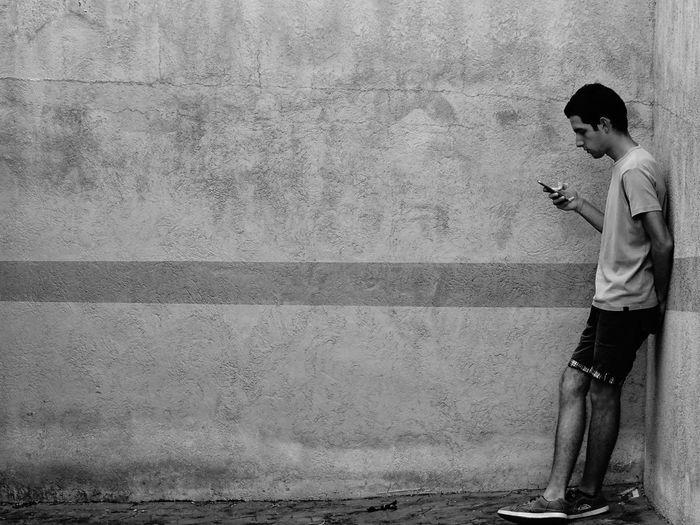 Full length of man using smart phone