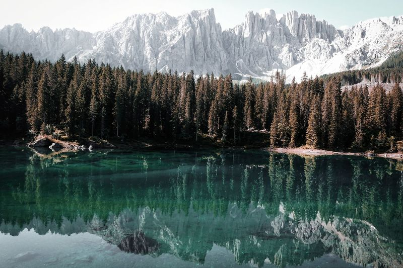 Scenic view of lake and snowcapped mountains during winter
