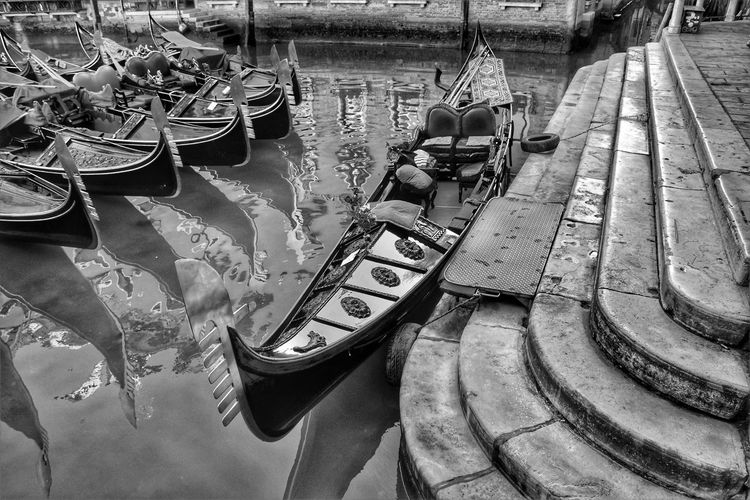 High angle view of boats moored in canal