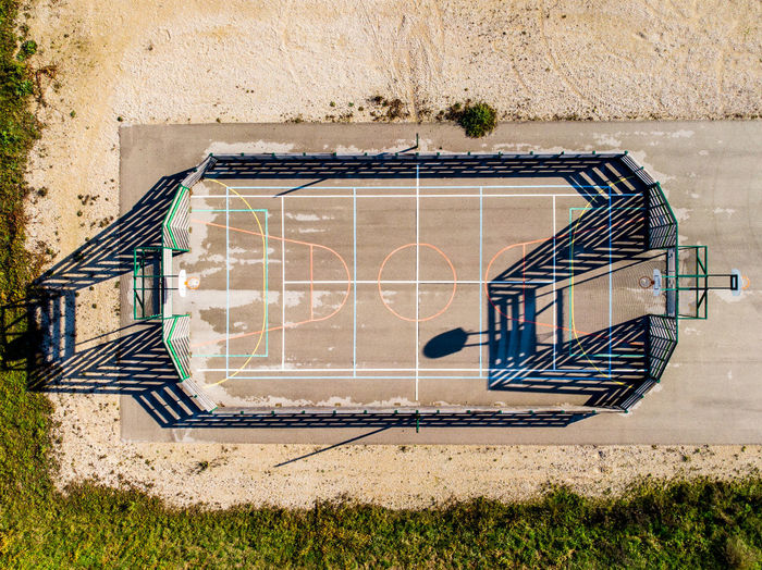 Aerial View Personal Perspective Playground Playground Equipment Sports Sport No People Field Basketball - Sport Football Shadow Architecture Built Structure Nature Staircase Plant Grass Sunlight Day Outdoors Wall - Building Feature Building Exterior Metal Railing Wall Building Steps And Staircases Pattern Spiral Ladder
