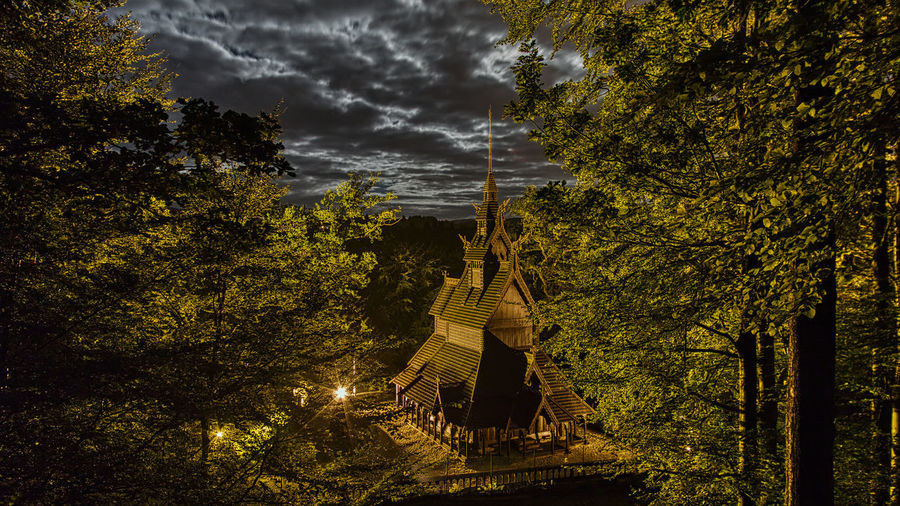 Stave church Fantoft Tree Plant Nature Cloud - Sky Sky Growth Land Forest Beauty In Nature Outdoors Architecture Real People Dusk Leisure Activity Built Structure Full Length Lifestyles People Night Tranquil Scene Ominous