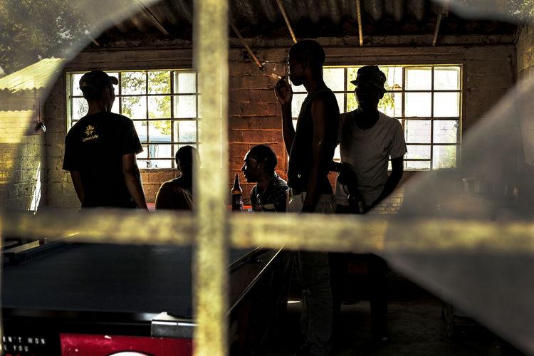 People standing in corridor of building