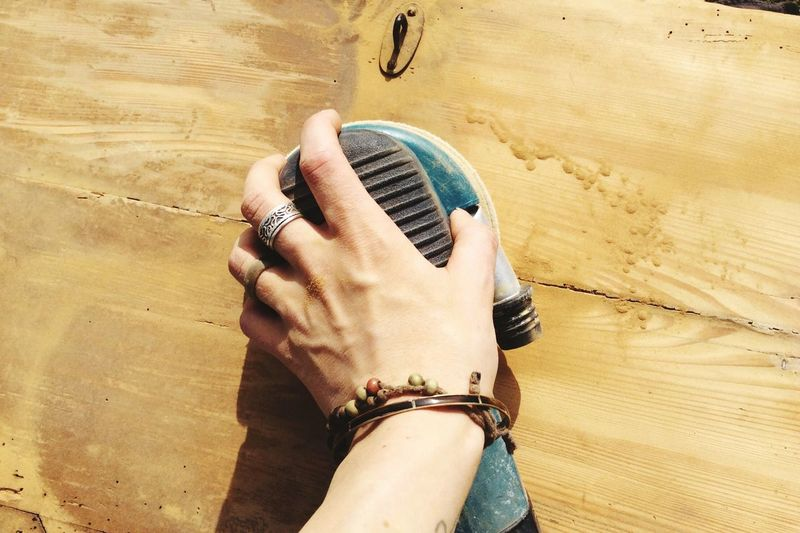 Man Hand Moving Sander On Wood Material