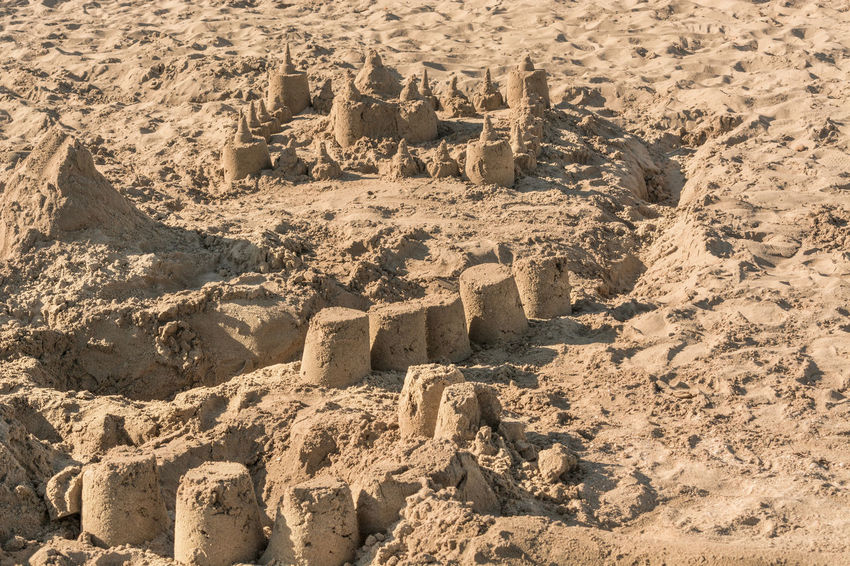 Small sand castle on a beach in Spain Beach Beachphotography Beautiful Beauty In Nature Brown Castle Childhood Day Full Frame No People Outdoors Sand Color Sandcastle Textured