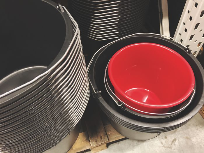 Red bucket in other buckets Plastic Cleaning Supermarket Hardware Store Shelf Pail Bucket Stacked Black Red Red Indoors  No People Table Still Life High Angle View Close-up Group Of Objects Bowl Container Household Equipment Communication