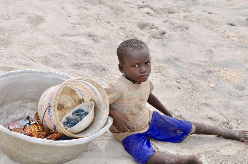 Portrait of boy sitting at beach