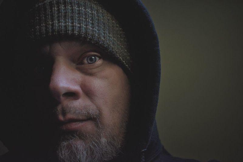 Close-up portrait of man wearing knit hat