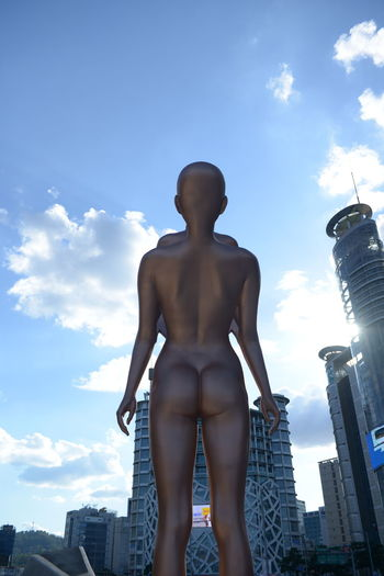 Sky Built Structure Architecture Building Exterior Human Representation Cloud - Sky Representation Low Angle View Day Male Likeness City Nature Sculpture Statue People Building Skyscraper Lifestyles Art And Craft Female Likeness Office Building Exterior