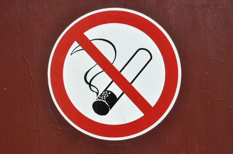 No smoking sign on red wall Smoking Worning Cigarette  Circle Communication Geometric Shape Information Information Sign Message Nicotine No Smoking Sign Prohibition Red Sign Smoking Issues Stop Symbol Warning Sign Warning Symbol