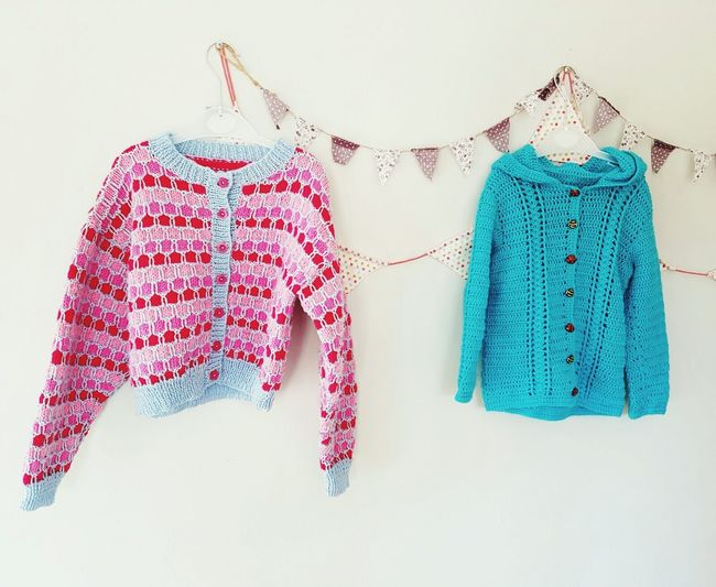 Hanging No People Coathanger White Background Jumpers  Bunting Fashion Kids Clothes Childrens Wear His And Hers Girls And Boys Girls Versus Boys Pink And Blue Blue And Pink Handmade Knitted  Crochet Vintage Handmade Clothes