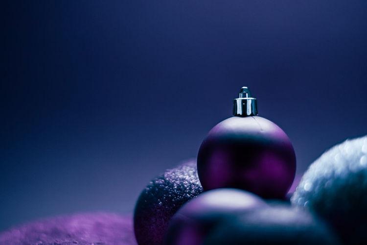 Close-up of bottle against blue background