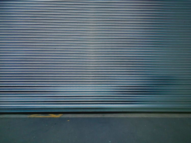 Brixton. Corrugated Iron Pattern Shutter Backgrounds Metal Close-up Garage Closed Doorknob Door Corrugated Brushed Metal Silver - Metal Aluminum Visual Creativity The Architect - 2018 EyeEm Awards #urbanana: The Urban Playground