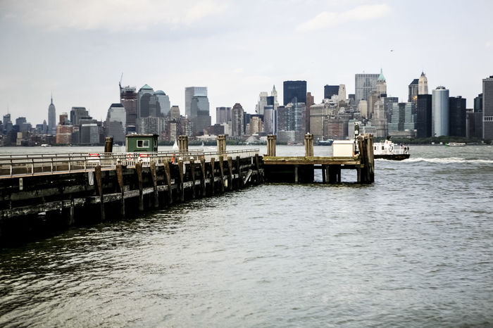 Architecture Boat Bridge Bridge - Man Made Structure Building Exterior Built Structure City City Life Cityscape Connection Engineering Hudson River Manhattan Modern Outdoors Railing Reflection Residential District River Riverscape Ship Skyline Water Waterfront