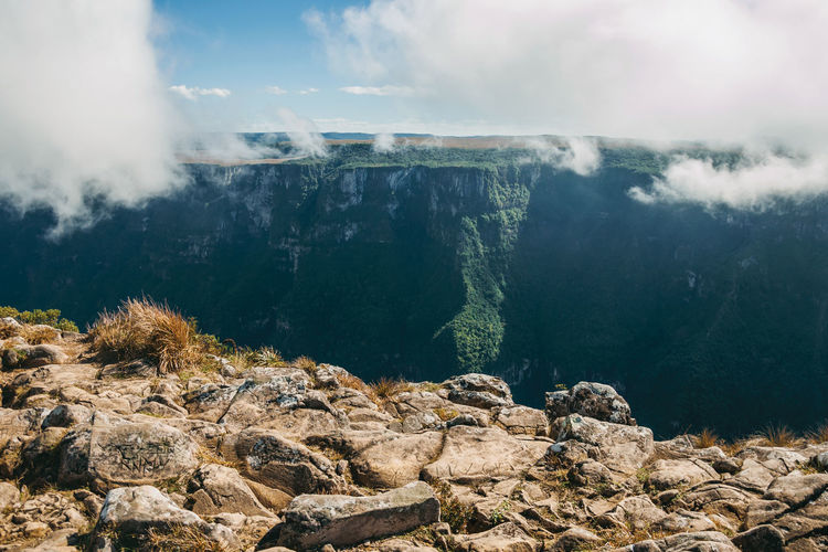 Fortaleza canyon with steep rocky cliffs and mist coming up. near cambara do sul. brazil.