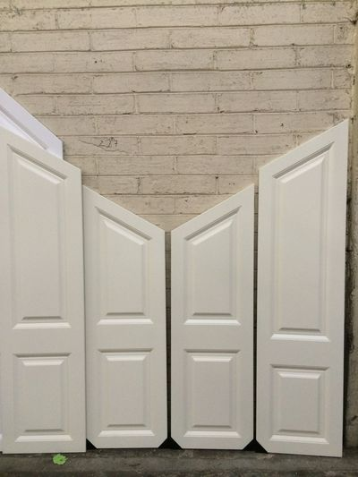 Precision mtm doors from work Angled to a made to measure size these doors sizes start from 2250mm high to 1595mm and 495mm in width these doors are very intricate to make and expensive when ordered !! When we are ordering these up we the customer must be very precise to what he wants doors made at !!