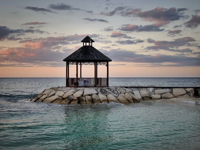 Sea Water Sky Horizon Over Water Horizon Beauty In Nature Scenics - Nature Cloud - Sky Sunset Tranquil Scene Tranquility Beach Land Built Structure Hut Gazebo No People Nature Idyllic