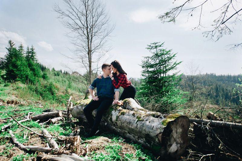 Loving Girlfriend Embracing Boyfriend In Forest