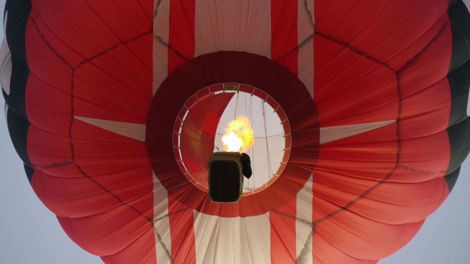 looking inside red hot air ballon flying high Red Color Red Hot Air Balloon Looking Inside Fire On Sky Part Of Object Basket Full Frame Firing  Burn EyeEm Gallery EyeEm Selects Transportation Ballooning Festival Red Low Angle View Illuminated No People Hot Air Balloon Outdoors Close-up Concentric Sky An Eye For Travel Go Higher Summer Sports