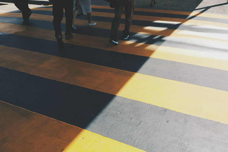 Stepping Contrast Highlight Hazard Road City Design Safety Jeans Walk Sneaker People Black Shadow Symbol Traffic Yellow LINE Sign Foot Forword Street Caution Zebra Crossing EyeEmNewHere Paint The Town Yellow