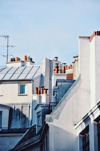 The rooftops I fell in love with. Geometry Architecture Looking Up Urban Geometry Paris Chimney EyeEm Selects Architecture Building Exterior Built Structure Building Residential District City Sky Sunlight Low Angle View Town Apartment Roof