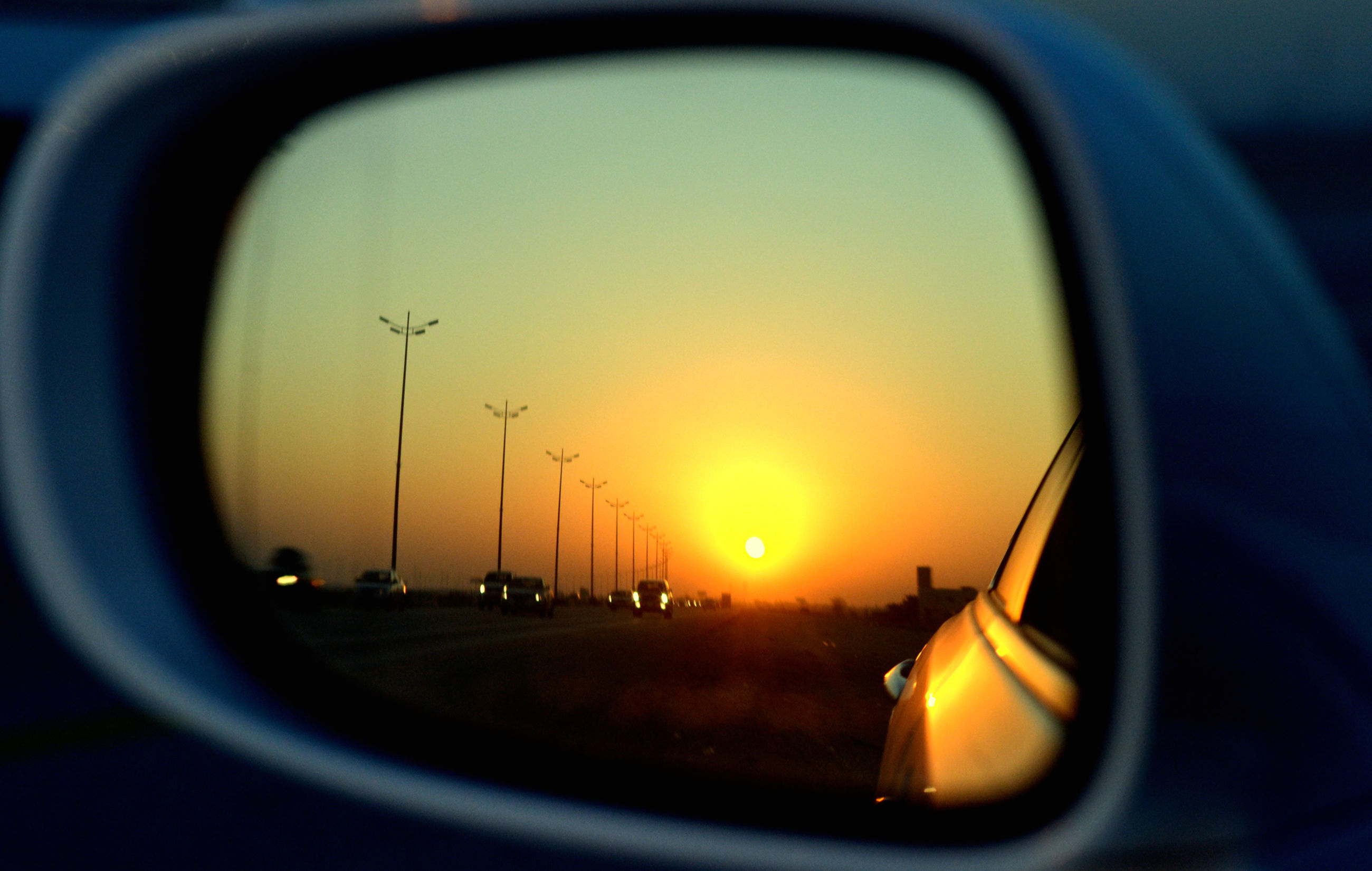 transportation, mode of transport, sunset, car, land vehicle, vehicle interior, sun, orange color, airplane, travel, air vehicle, glass - material, transparent, on the move, sky, side-view mirror, windshield, car interior, road, part of