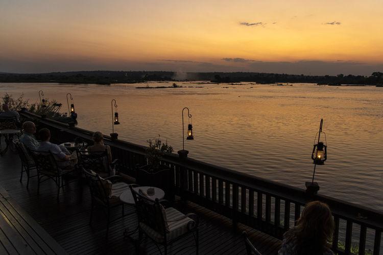 Scenic view of zambezi riveragainst sky during sunset