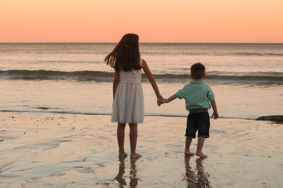 watching the sunset brother sister love Colour Your Horizn Beach Beauty In Nature Bonding Boys Childhood Full Length Girls Horizon Over Water Leisure Activity Lifestyles Love Nature Outdoors Real People Sand Scenics Sea Sky Standing Sunset Togetherness Two People Walking Water Women