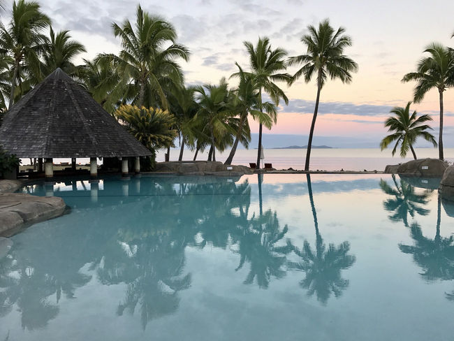Architecture Beauty In Nature Day Horizon Over Water Luxury Nature No People Outdoors Palm Tree Scenics Sea Sky Swimming Pool Thatched Roof Tranquil Scene Tranquility Tree Tropical Climate Vacations Water
